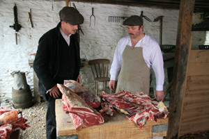Cutting meat on Edwardian Farm, Morwellham Quay